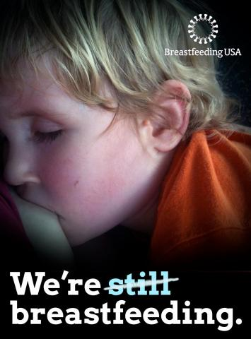 "A young child is asleep at the breast. ""We're still (struck through) breastfeeding."""